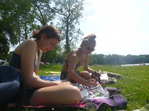 Gina and Ali painting with water colors beside Elk Lake